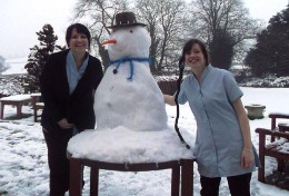 Image of staff members building a snowman